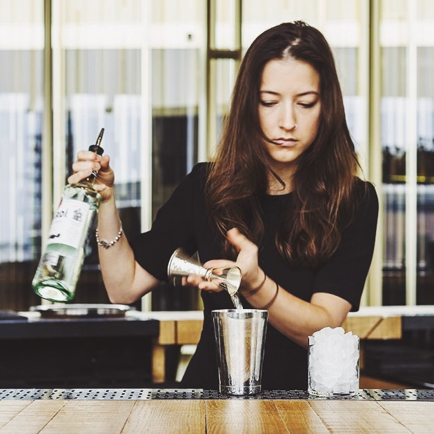 Anya mixing drinks at Mr. Porter, Amsterdam